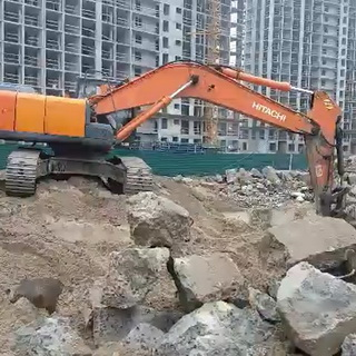 Excavator on demolition work