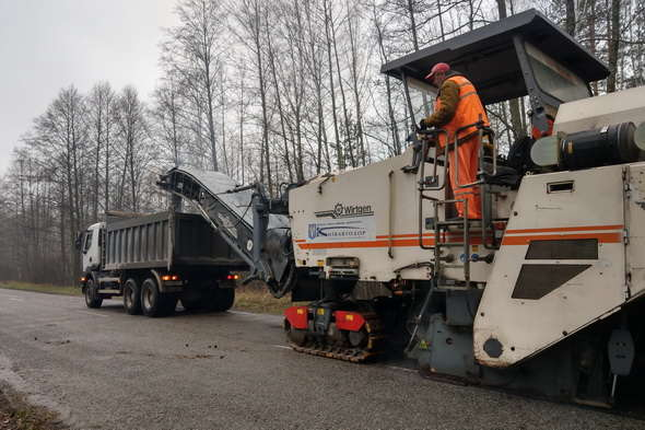 Large milling machine for removing of asphalt Wirtgen W 210 and Renault Kerax 380 dump truck. Complete pavement removal