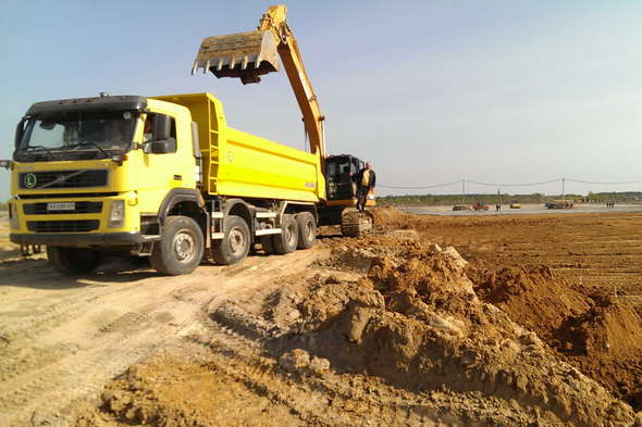Earthworks with the special technics in the construction of a wood processing plant in Korosten
