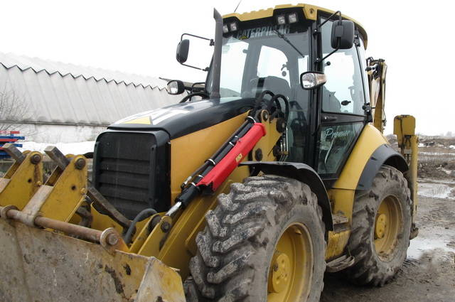 AVTOGRAN Company machinery rental: Skidsteer Loader Caterpillar 444 E with hydrohammer